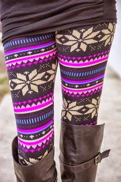 Colorful leggings with sweater and tan long boots for fall