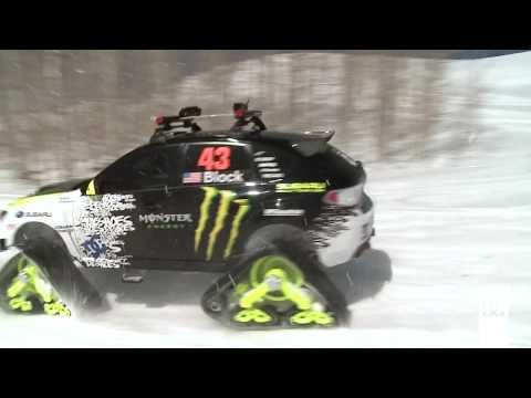 Ken Block on Subaru Rally car equipped with Mattracks for snow