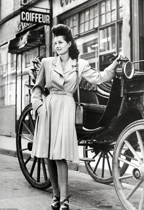 Fashion in France, c. 1944 - now that is some serious hair volume! #vintage #1940s #hair