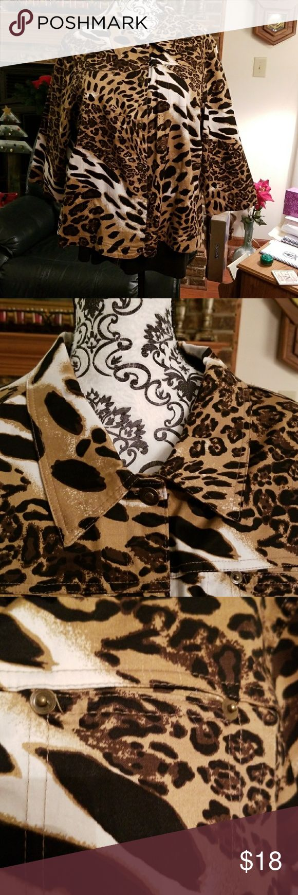 Animal print jacket EUC. Mirror Image animal print jacket. Unlinked and lightweight. Can be worn as a jacket or a blazer. Very comfortable with some stretch from.the spandex. Pair it with black, Brown or cream dress pants for office or a pair of jeans for weekend wear. Mirror Image Jackets & Coats Blazers