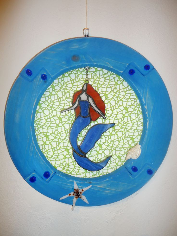 Stained glass mermaid in a wooden circle frame