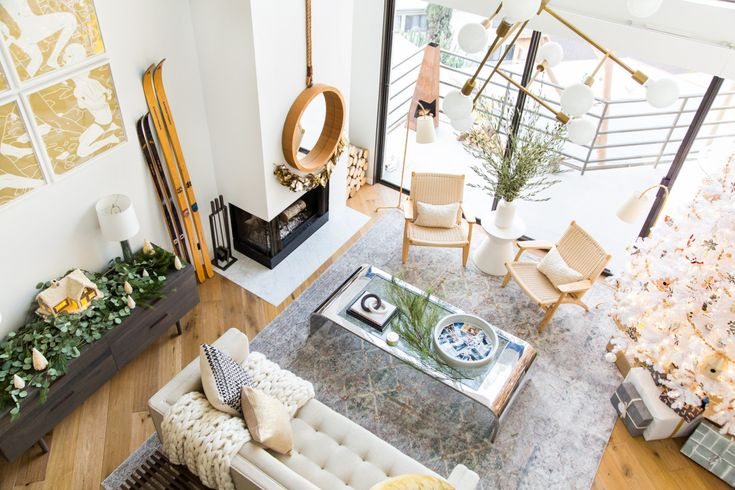With the help of greenery and strategically placed props (hello, skis!), the Los Angeles condo suddenly has the air of a wintry lodge.