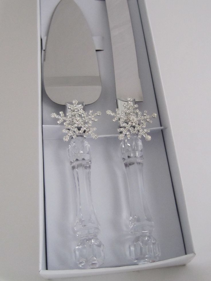 Rhinestone  Snowflake  Winter  Wonderland  cake  server  set - $19.95  per  set.  Faux  crystal  and  stainless  steel  cake  server  set  hand  decorated  with  rhinestone  Snowflakes. This  cake  server  set  sparkles  in  the  sunlight  of  a  Winter  Wonderland  wedding. For  more  info  please  contact - Shoot  for  the  Moon  Jewelry  Designs (850) 230-9983 #winterweddings #handdecoratedinUSA