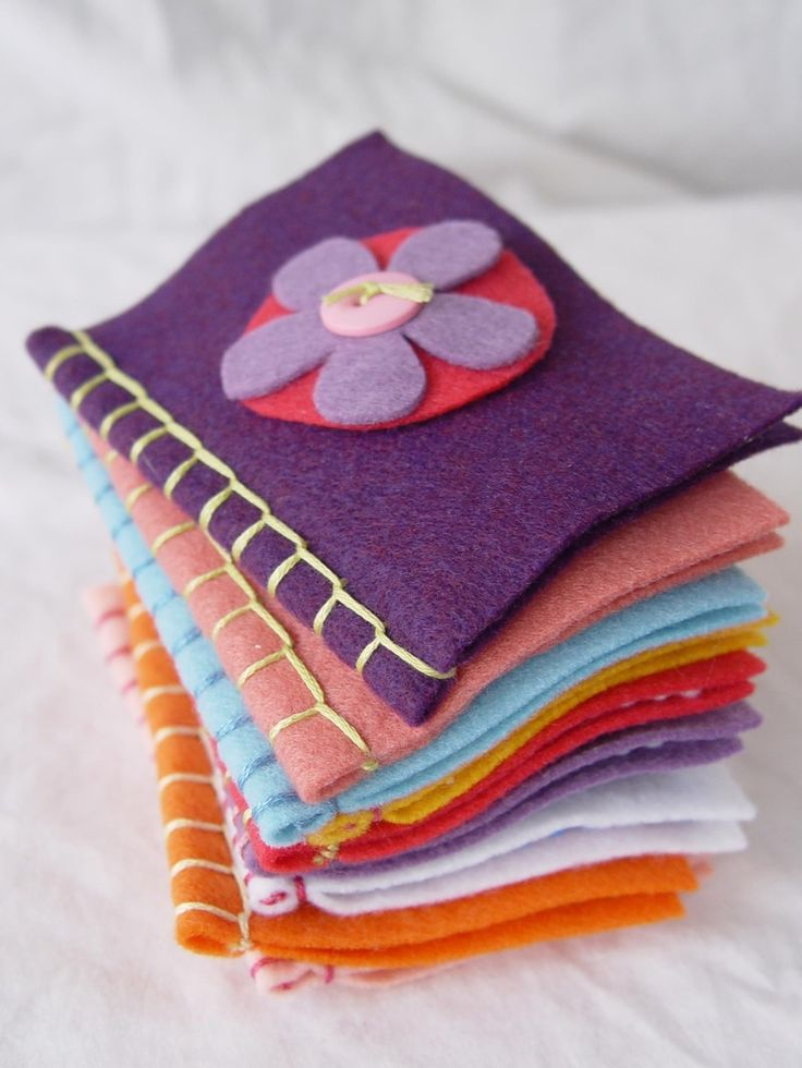 Neat little felt books by ya Think?  I have some of these already made, but I like the detail of the blanket stitch on the binding.  We use them for quiet books for church and I make them in liturgical colors with seasonal religious symbols