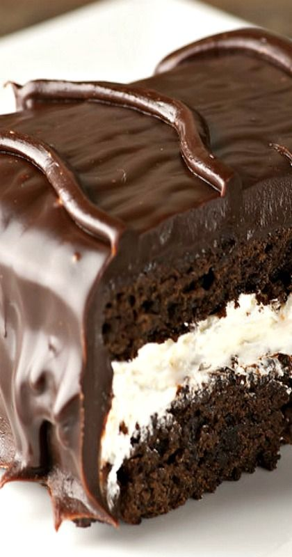 Chocolate Dinner Mint Cake - it's actually a brownie cake with a cool, creamy, minty filling...just like those delectable After Dinner Mint candies. Smothered in chocolate frosting, this cake is swoon worthy!