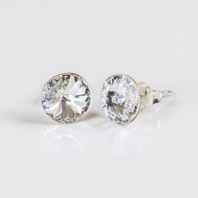Swarovski Rivoli Earrings 8mm Crystal  Dimensions: length:1,5cm stone size: 8mm Weight ~ 1,15g ( 1 pair ) Metal : sterling silver ( AG-925) Stones: Swarovski Elements 1122 SS39 ( 1122 8mm ) Colour: Crystal 1 package = 1 pair Price 9.90 PLN( about`2,5 EUR)