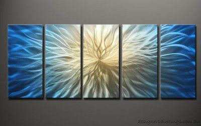 The wall sculptures are made by polishing and grinding on the aluminium plate adding special pigment.