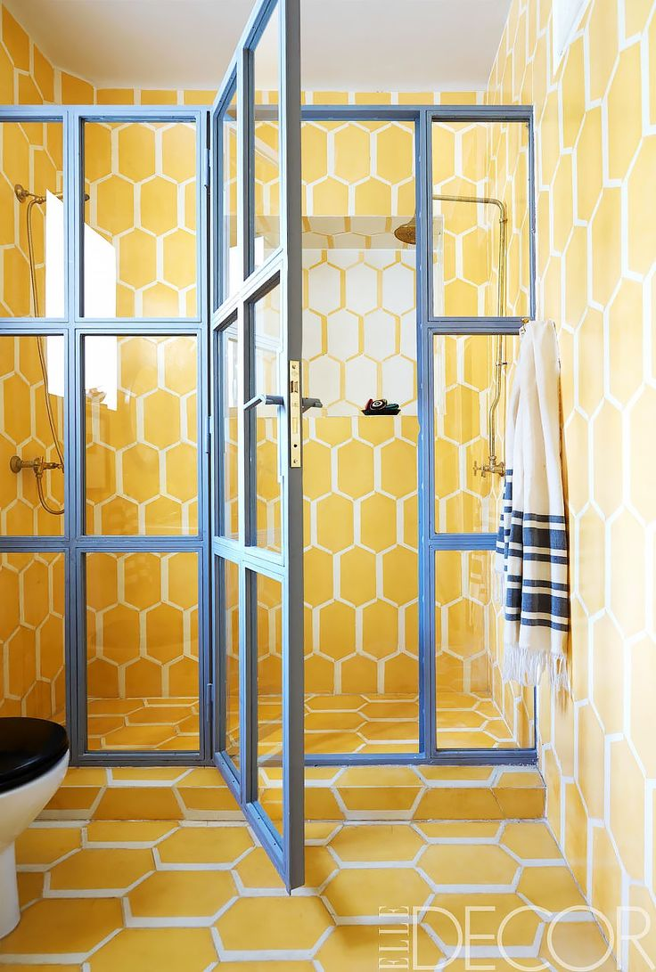 I would be afraid I would tire of these yellow tiles, but that shower door is everything!  @MyDomaine