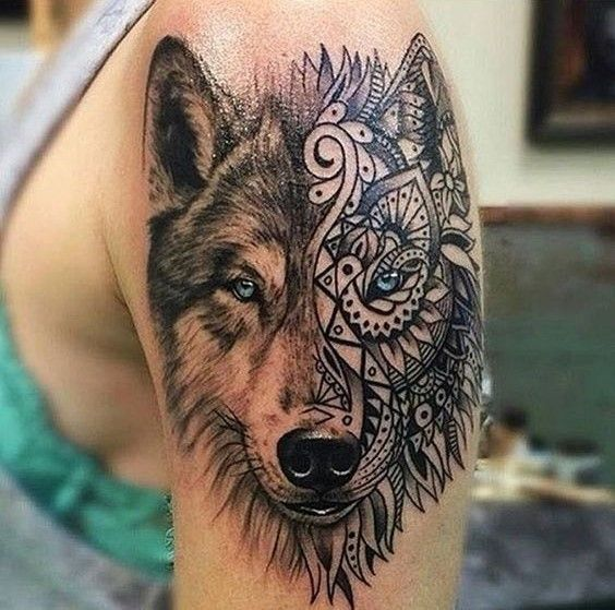 Cool half tribal portrait wolf tattoo.