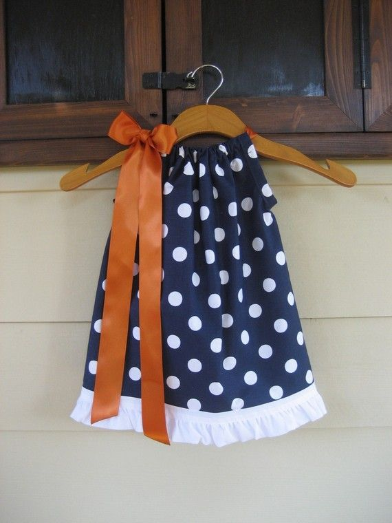 I bought this for my daughter and had it monogrammed in the same orange color as the ribbon, super cute.  Perfect for our Auburn football games.  Navy Blue Polka Dot Pillowcase Dress  sizes 3m to by theuptownbaby, $25.00