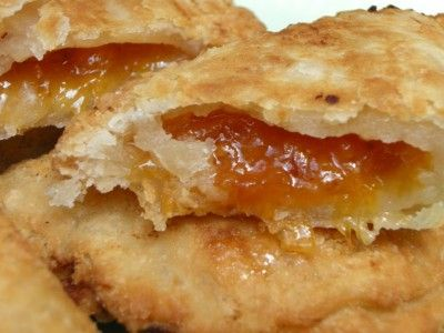 Lela's Fried Peach Pies With Dried Fruit, Sugar, Water, Butter, Lemon Juice, Cinnamon, Flour, Salt, Shortening, Milk