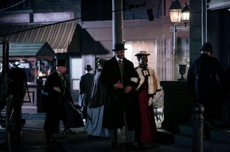 "Jordan Johnson-Hinds (""Nate"") and Mouna Traoré (""Rebecca James"") film a scene on the backlot at the Murdoch Mysteries studio"