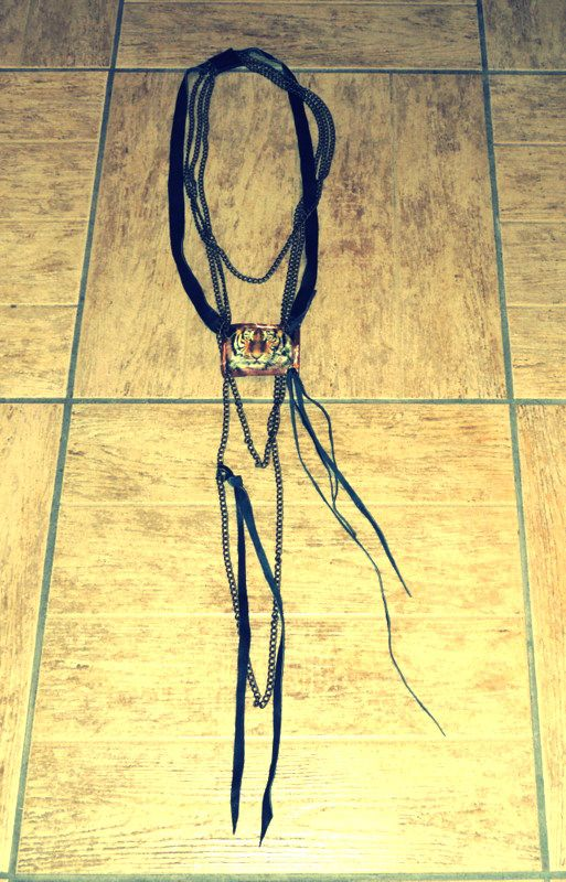 Handmade leather necklace with chains.