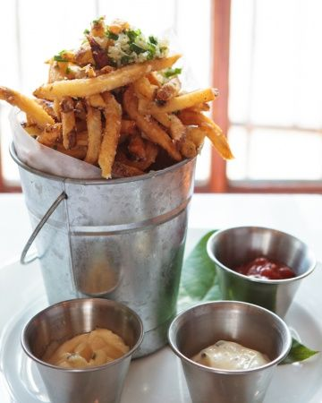 Seasoned truffle fries with three gourmet dip choices: garlic aioli, truffle mayo, and chipotle ketchup