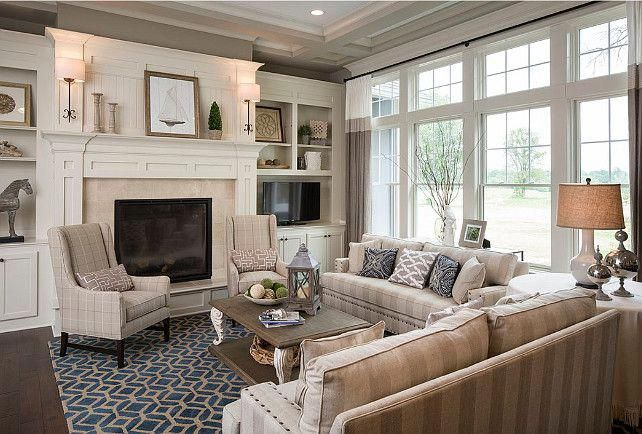 Family Room Feels Sophisticated And Also Very Cozy With Its Navy Blue Accents The Fireplac Family Room Layout Livingroom Layout Living Room Furniture Layout