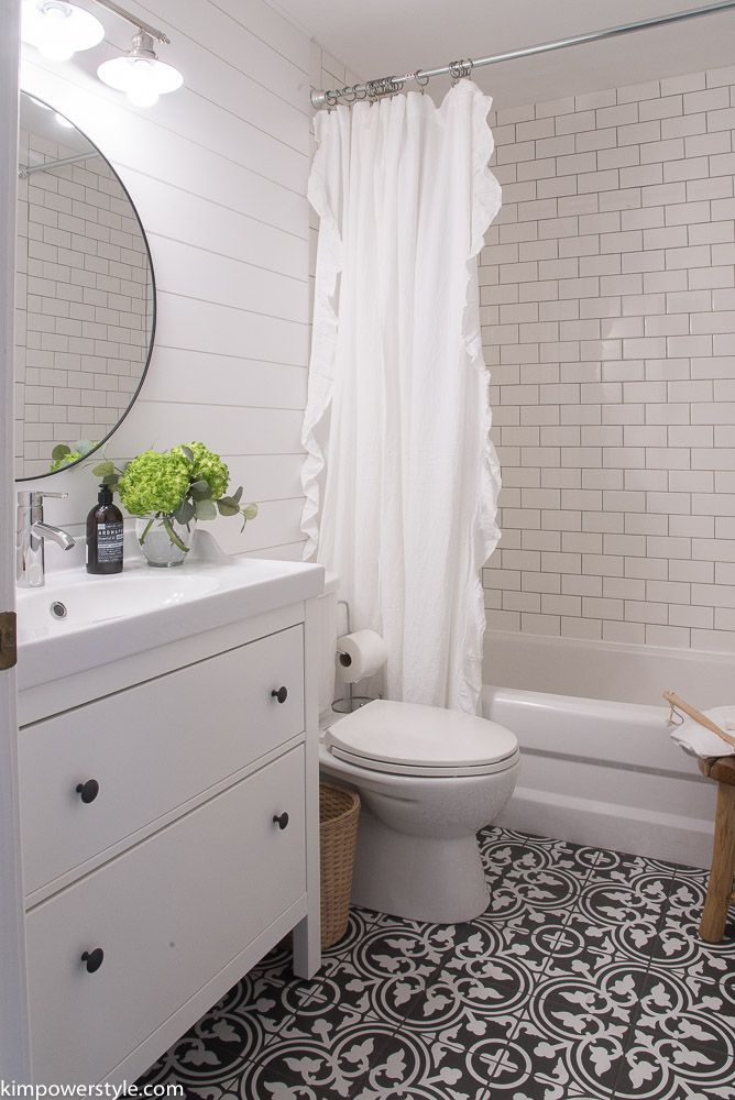 Kids bathroom (main) in Winston custom. Skirted tub with simple subway tile, cement tile floor, Ship lap?