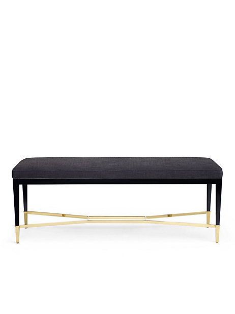 because rooms should be mix-and-match affairs of hand-curated pieces acquired from travels near and far--plus classic pieces with a feminine twist, like this bench with a subtle brass 'bow.'