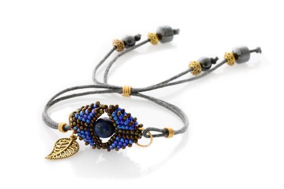 A Beautiful minimalist and Boho inspired bracelet is the beaded Evil Eye Bracelet,    Comes in different colour schemes.  This one is Blue and Bronze seed bead with a gold filigree leaf dangle on the side.  Grey wax cord used for the band with gold plated spacers and hematite beads.    Beaded Evil Eye is approx. 3 x 2cm  One size fits all, you can wear as is or tie the ends.    Code: KTC-318    (Colours may vary from screen to screen depending on settings)…