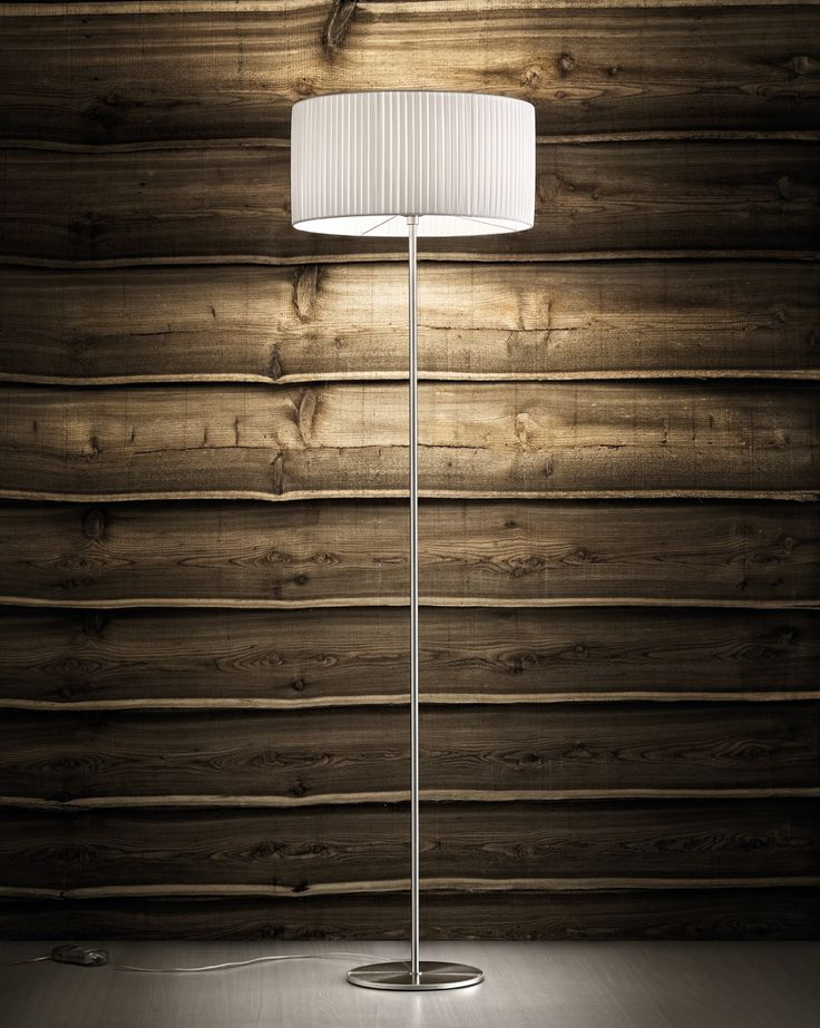 "The ""Fog plissè"" floor lamp by Morosini joins refined elegance with functionality.  This lamp creates  a beautiful diffused light, thanks  to its ""Plisse fabric"" shade and to a blown globe glass internal diffuser.  The metal part is in nickel satin finish.  ON/OFF dimmer switch on cord."