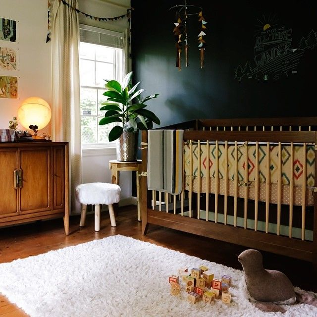 Interesting combination of ethnic and mid-century in this boy's nursery