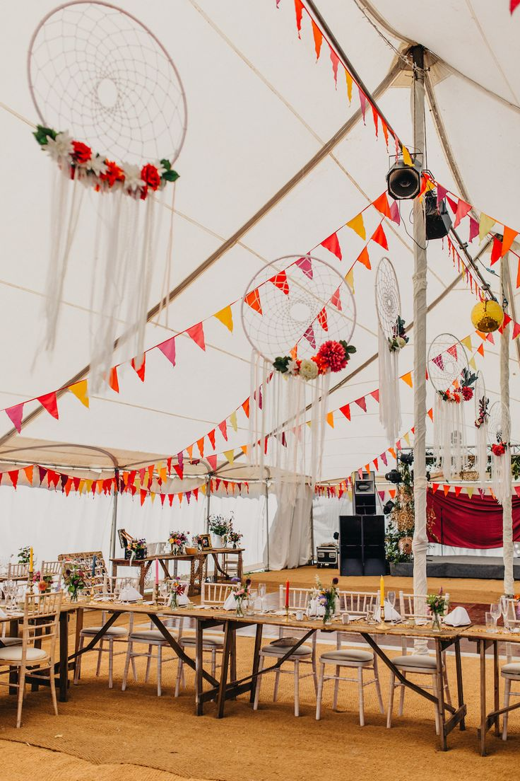 Colourful Bunting Wedding Decor for a Festival Themed Marquee Wedding