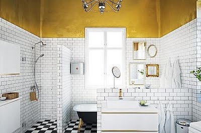 gold and white bathroom with vintage details