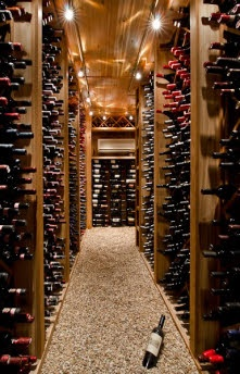Wine cellar with gravel floor - I would imagine there would be fewer broken bottles here.