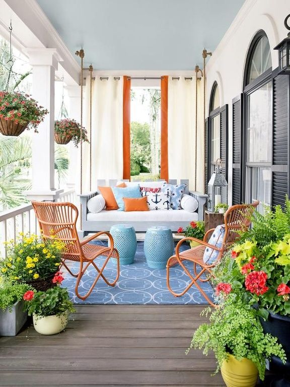 Eclectic Porch with Rizza Outdoor Seating, Wrap around porch, Arched window, How To Add Decorative Trim to Curtains