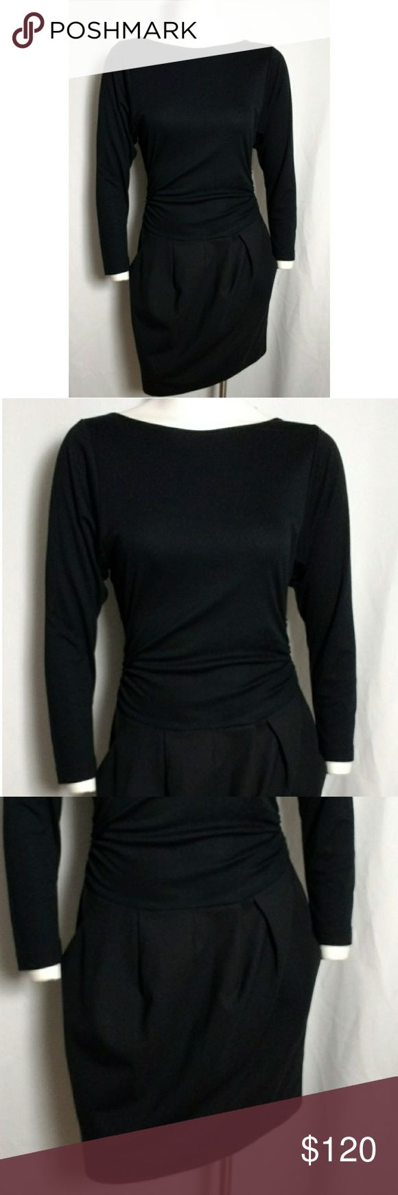 Theory Black Long Sleeve Short Dress Urban chic little black long sleeve dress! Features long sleeves, hidden side zip, sides are ruched, pleated lantern skirt, side pockets, high neckline, scoop back, combo fabric is awesome! The top is super soft! the bottom is wool. For the sophisticated contemporary woman!   // 96% Wool - 4% Lycra  // 59% Modal - 41% Triacetate Theory Dresses