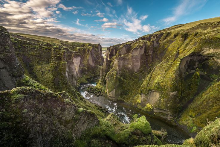 "Fjaðrárgljúfur is a canyon in south east Iceland which is up to 100 m deep and about 2 kilometres long, with the Fjaðrá river flowing through it. It is located near the Ring Road, not far from the village of Kirkjubæjarklaustur."" Photographer: W&AC Visual Arts"