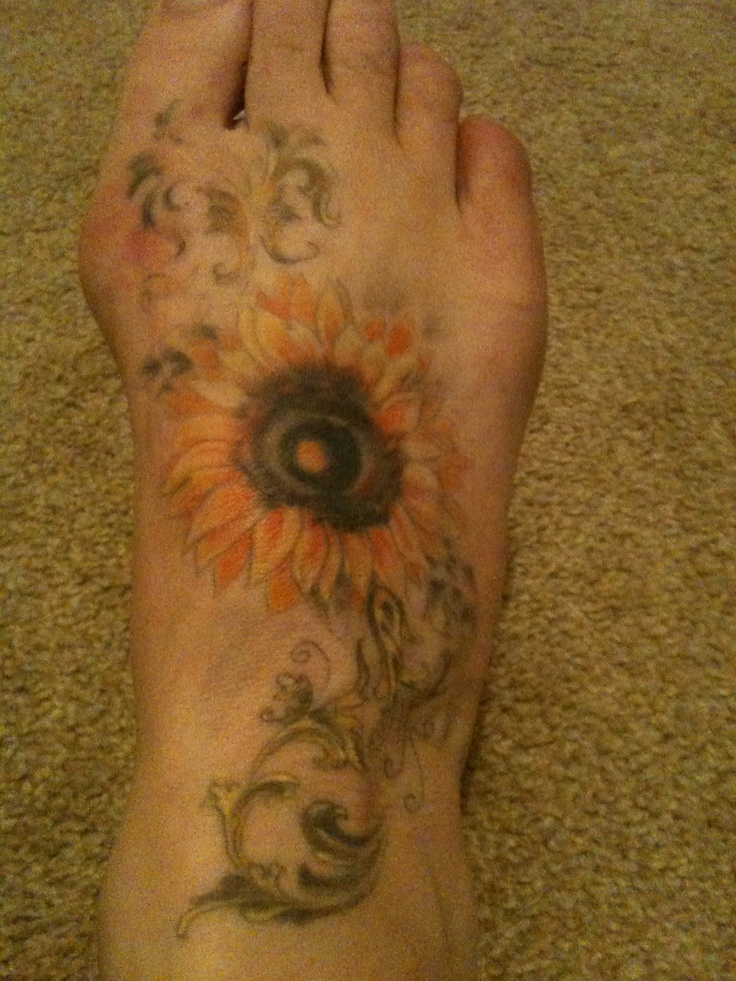 Sunflower tattoo- just not on the foot! Ouch