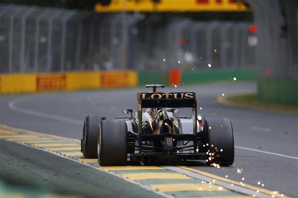 Sparks as Kimi Räikkönen's car touches the track - 2013 Australian GP