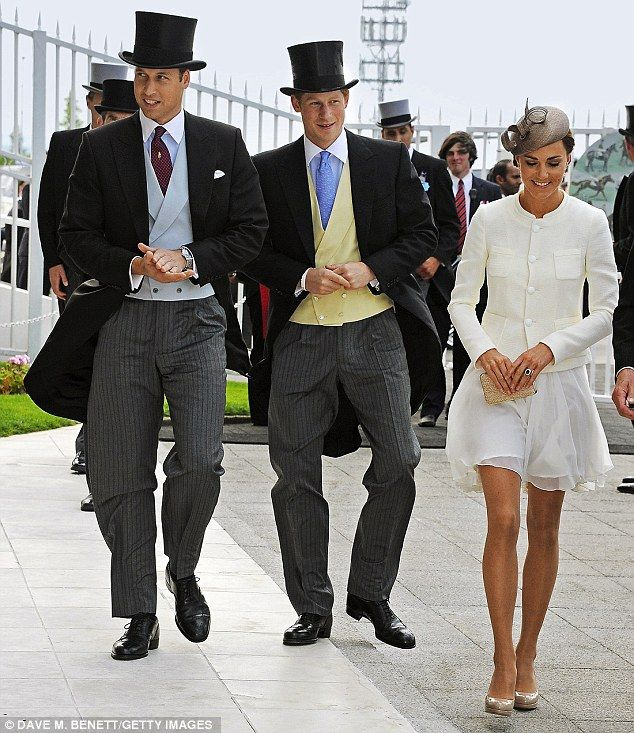 Top hat and tails: A well-dressed threesome at Epsom in June last year