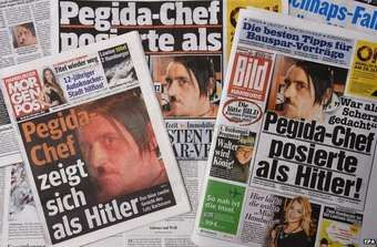 German newspapers carrying the photo of Pegida leader Lutz Bachmann with his moustache, 21 January