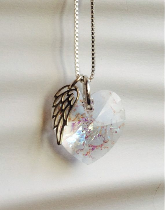Featuring a beautiful white patina Swarovski Crystal, this memorial necklace is a lovely way to cherish the memory of loved one or friend and includes a silver angel wing charm.