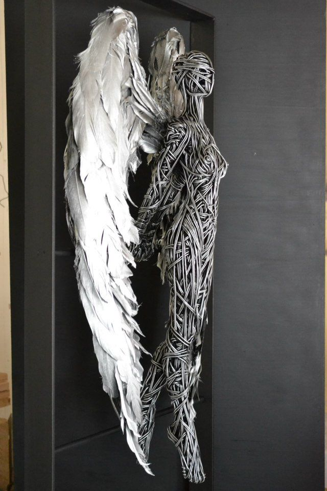Angel Sculpture --  English artist Richard Stainthorp captures the beautiful energy and fluidity of the human body using wire. The life-sized sculptures feature both figures i