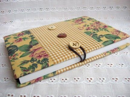 I have made the notebook cover with 100% cotton.It is Hand made and machine quilted.It is designed by me and unique.The dimension is approximately 10.7cmx15cm.The blank notebook is ncluded.It fits all notebook of 10.2cmx14.7cm.I will give two FREE gift tags which are made with paper and fabric with something you purchase.ship to worldwide,$10  PAYPAL only