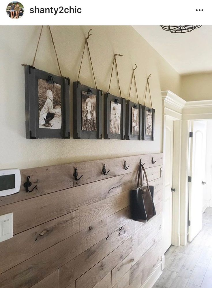 I love the barn wood halfway up the wall and the shelf above it! And the pictures hanging. Its only missing a bench.