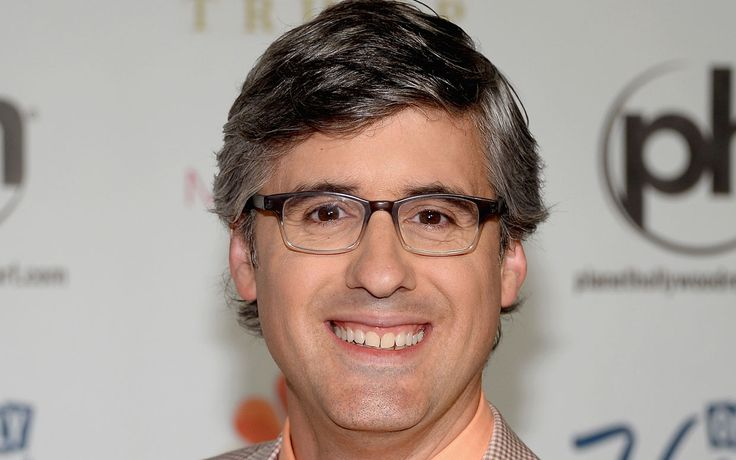 Comedian Mo Rocca is a look-a-like of Teen Vogue's style director Andrew Bevan, Sprint spokesman Paul Marcarelli, and Waldo.