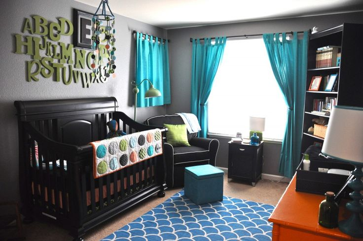 These turquoise curtains and rug look great with the black furniture.  #turquoise #nursery #curtains
