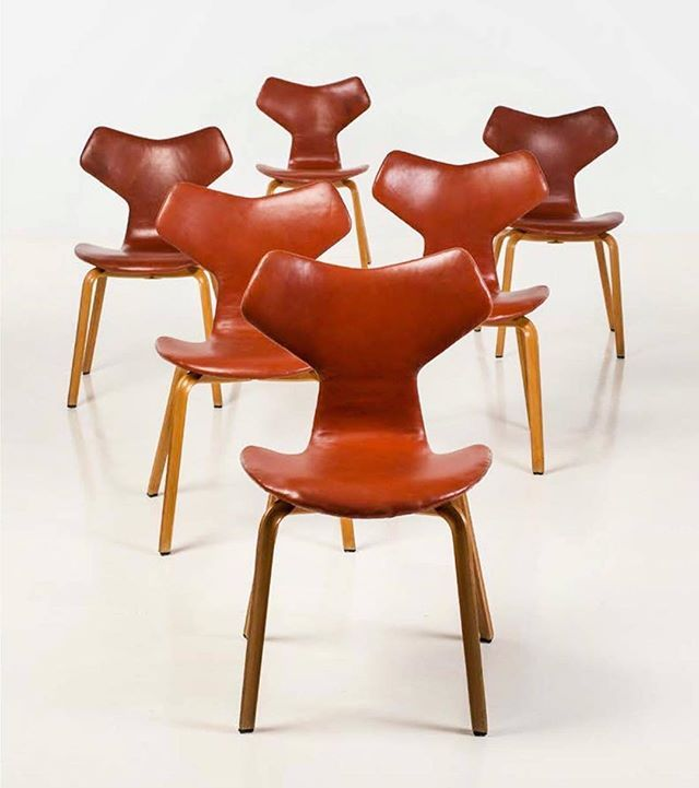 Leather-upholstered 'Grand Prix' chairs (model 4130) designed by Arne Jacobsen and produced by Fritz Hansen of Denmark in 1955.