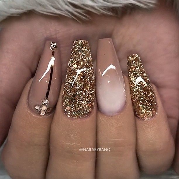 "REPOST - - - - Hazelnut-Brown Gold Glitter and Crystals on long Coffin Nails - - - - Picture and Nail Design by @nailsbybano Follow her for more gorgeous nail art designs! @nailsbybano @nailsbybano - - - - Products used: @jet_set_beauty_nails One Stroke Colour Gel ""Hazelnut"" Glitter (custom mixed) Swarovski Crystals Striping Tape - - - -"