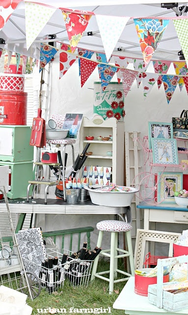 colorful booth display ~ love the bright bunting