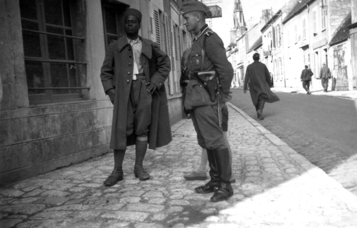 A Senegalese soldier is taken as a prisoner of war by the Germans in Évreux, Haute Normandie, France in 1940. The African soldier was a member of the Senegalese Tirailleurs, a corps of colonial infantry the French Army recruited from Senegal. The...