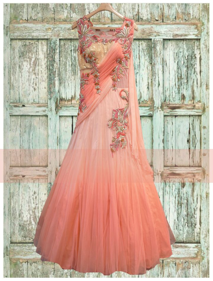 This timeless beauty is a perfect outfit for #ikhadestinationwedding.The soft #ikhapastel #ikhapeach and pink net #ikhagown gels in with the golden sequined bodice nicely.The peacock and floral motifs are an amalgumation of #ikhazardozi, #ikhathreadembroidery, stone and sequin work ,which along with the shoulder trail will never miss to seize your attention...