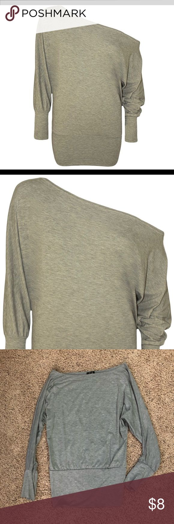 Grey off-shoulder batwing top Grey off-shoulder batwing top. The bottom is fitted with some stretch. This is a soft, Jersey like material. Goes with jeans or leggings. Size 12-14 but fits small. Tops Tees - Long Sleeve