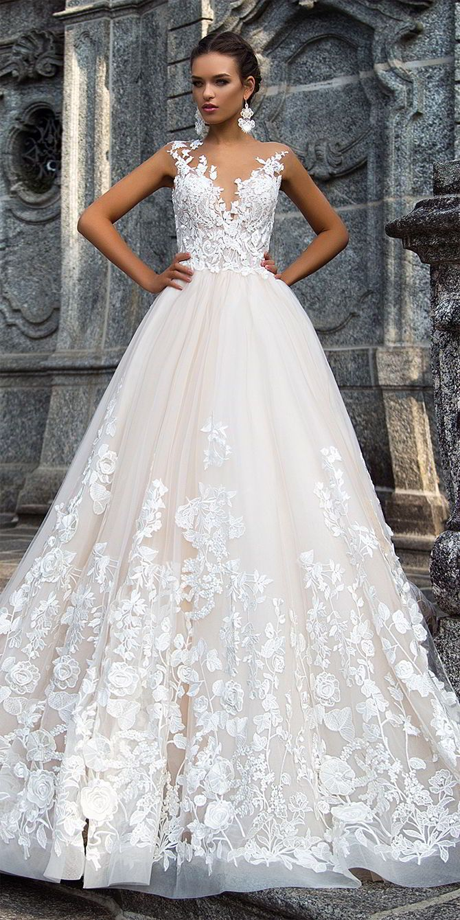 Splendid wedding gown Milena is made of classy rayon, chic organza, tender gauze and French lace. The deep décolleté corset and the bottom of an airy-fairy skirt are manually decorated with 3D lace flowers and petals. Hem falls to the floor.