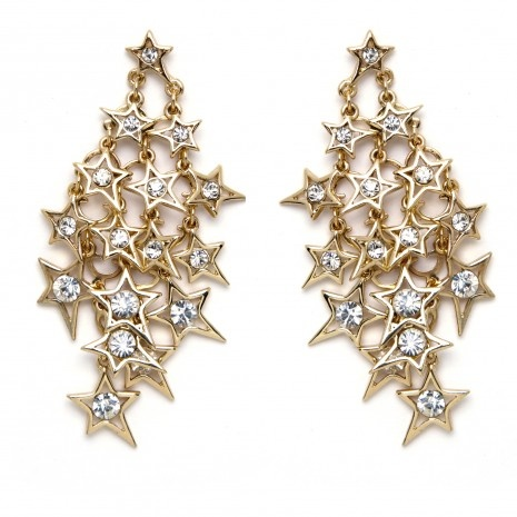 """Cascading goldtone stars highlighted by a glass rhinestone adorn these chandelier earrings on surgical steel posts. Earrings are 3"""" long."""