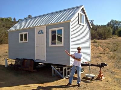 Me and my lil' house: I used maintenance free vinyl siding to prevent having to paint the exterior every other year and a metal roof for water collection for the shower and