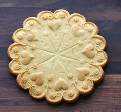 Pretty cookie moulds and recipes from Anne L Watson - some lovey pressed cookies here!